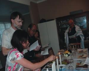 Lisa lighting the candle