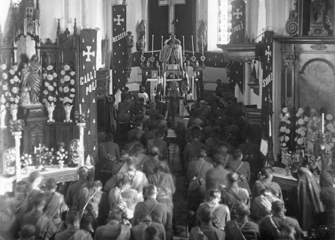 Soldiers commemorating All Souls' Day in a church in Selle, France