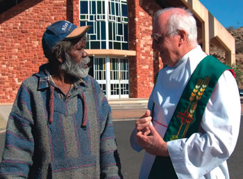 Fr Jim Knight talks with a Parishoner in Central Australia