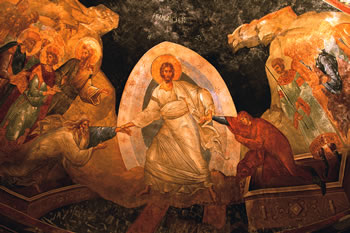 This fresco is in the 11th century Church of the Holy Saviour in Chora, Istanbul. Christ is pictured saving Adam and Eve by dragging them from their coffins. Note that the Saviour pulls Adam and Eve by their wrists, a symbol of their inability to do anything for themselves – the work of saving is Christ's alone. Behind Adam stand John the Baptist, David and Solomon.