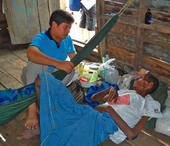 Fr Gil Casio sm visits an HIV AIDS patient living in Ranong