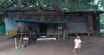 For many Burmese migrant families, homes are tin sheds