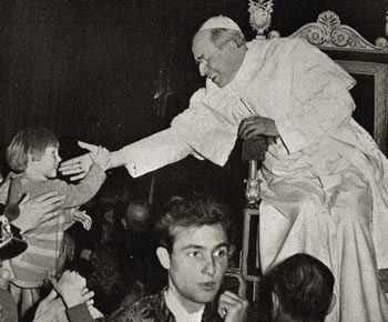 Pope Pius XII blessing a child, 1955
