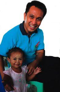 Fr Kevin Medilo sm with a pre-schooler